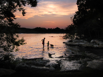 Mother and child playing in lake at sunset (C) Carrell Grigsby Photography